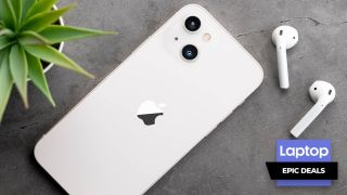 iPhone 13 in white with AirPods