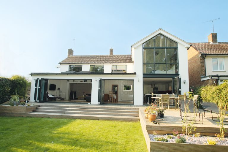 Two storey glass extension real homes for Patio home plans with rear garage
