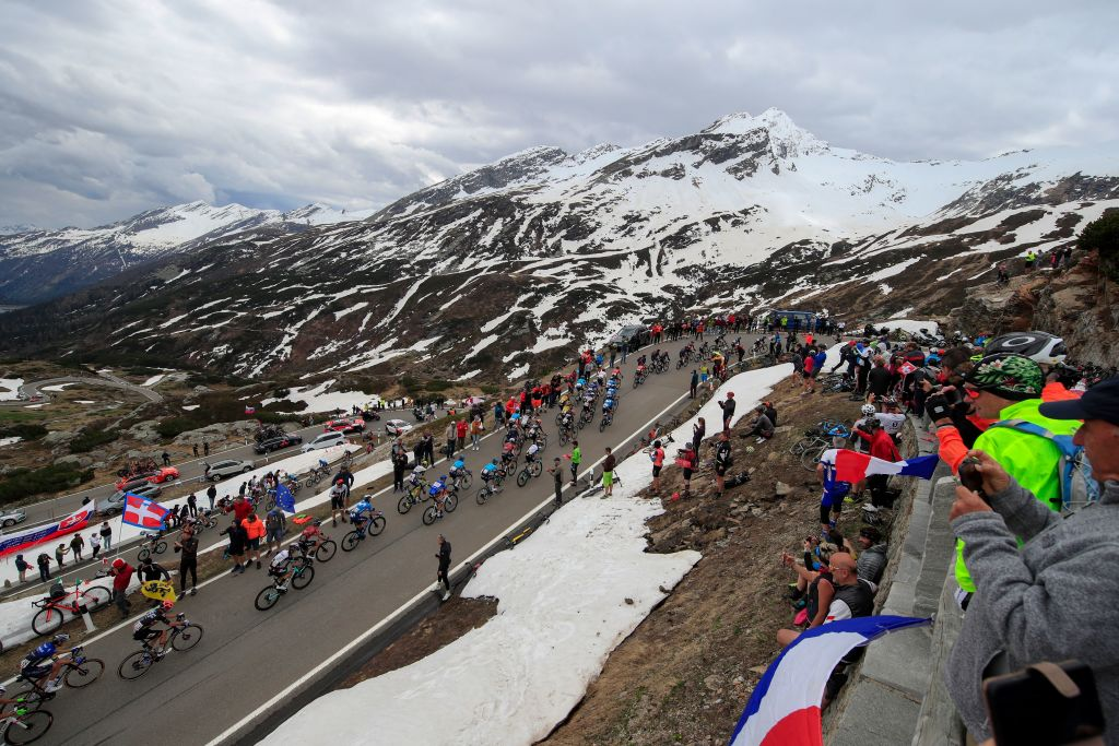 Spectators cheer as the pack rides in the ascent of the San Bernardino pass Switzerland during the 20th stage of the Giro dItalia 2021 cycling race 164km between Verbania and Valle Spluga Alpe Motta Madesimo on May 29 2021 Photo by Luca Bettini AFP Photo by LUCA BETTINIAFP via Getty Images