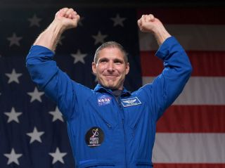 NASA astronaut Michael Hopkins celebrating the announcement in August 2018 that he would be flying to the International Space Station on the first full-fledged mission of the SpaceX Crew Dragon.
