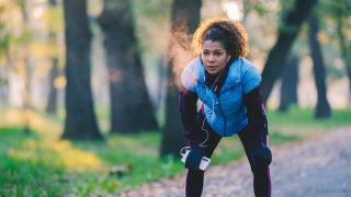 Respiratory system: A woman breathes into the cold as she takes a break from exercising.