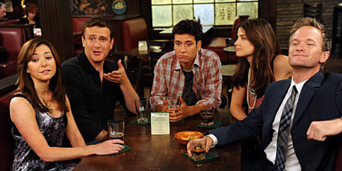 Some of the cast of How I Met Your Mother at their typical spot together.