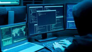 Hacker doing nefarious stuff with multiple monitors