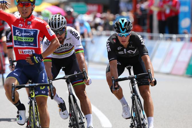 Peter Sagan and Danny Van Poppel cross the line behind Caleb Ewan