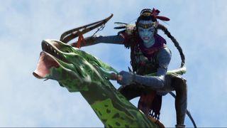 A blue alien riding a flying lizard thing