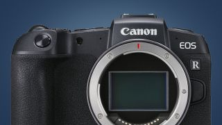 The Canon EOS RP without a lens on a blue background