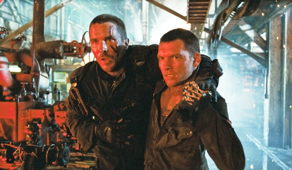 Terminator Salvation Sam Worthington helps Christian Bale around the factory