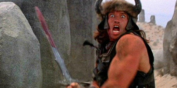 Arnold Schwarzenegger holding a sword in Conan