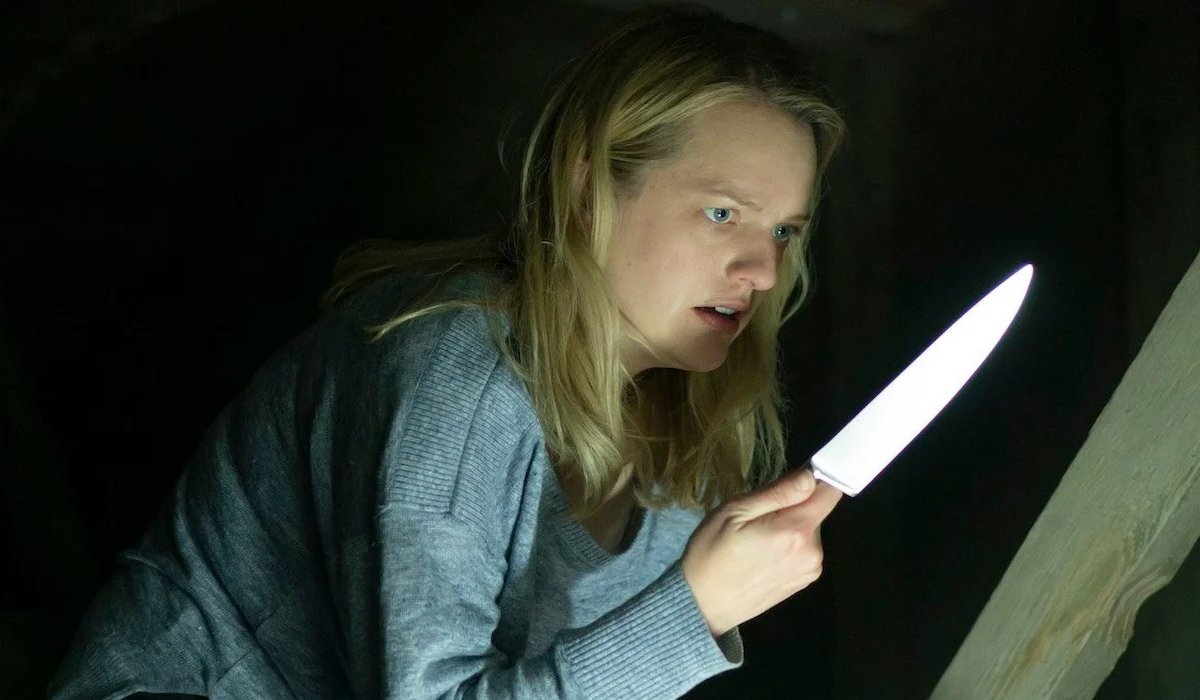 The Invisible Man Elizabeth Moss stares at a knife