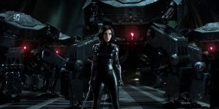Alita: Battle Angel Alita surrounded by security bots