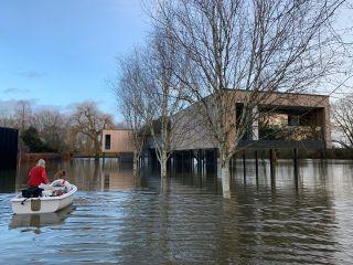 a self build home built on stilts above a flood plain
