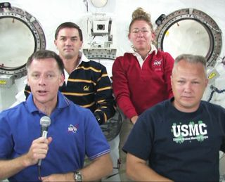 Final shuttle crew answers reporter questions