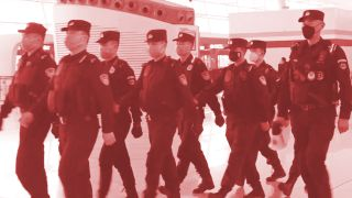 Policemen wearing masks as they patrol Wuhan Tianhe Airport during Wuhan coronavirus outbreak.