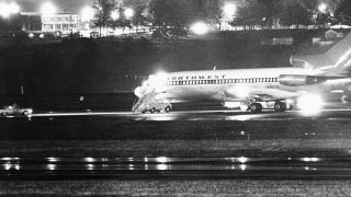 The hijacked Northwest Airlines jetliner 727 sits on a runway for refueling at Tacoma International Airport in Seattle, Washington on Nov. 25, 1971