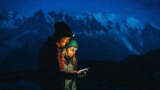 best weather apps: couple using one of our best weather apps for hiking