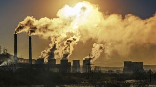 Greenhouse gases are being emitted into the atmosphere with dire consequences. Here, a factory emits a harmful gas.