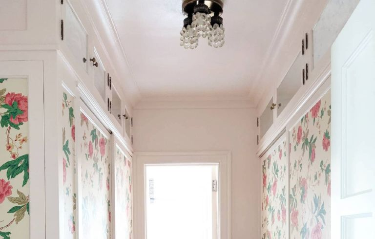 DIY mirrored closet uppers and floral wallpaper