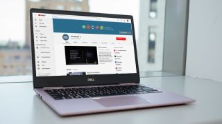 Downloading videos from TechRadar's YouTube channel on a laptop