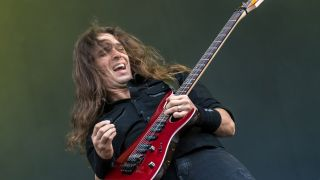 A picture of Kiko Loureiro on stage with Megadeth