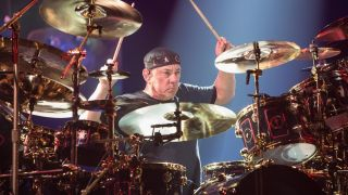 Neil Peart of Rush performs on stage during the R40 LIVE Tour at KeyArena on July 19, 2015 in Seattle, Washington
