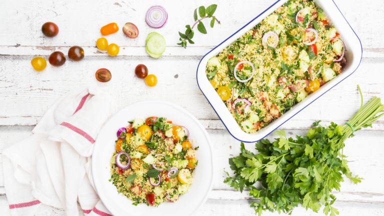 couscous flatlay with tomatoes, salad and mint