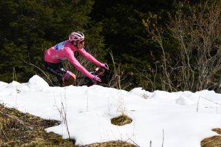 MADONNA DI CAMPIGLIO ITALY OCTOBER 21 Joao Almeida of Portugal and Team Deceuninck QuickStep Pink Leader Jersey Forcella Valbona 1782m Snow Mountains during the 103rd Giro dItalia 2020 Stage 17 a 203km stage from Bassano del Grappa to Madonna di Campiglio 1514m girodiitalia Giro on October 21 2020 in Madonna di Campiglio Italy Photo by Tim de WaeleGetty Images