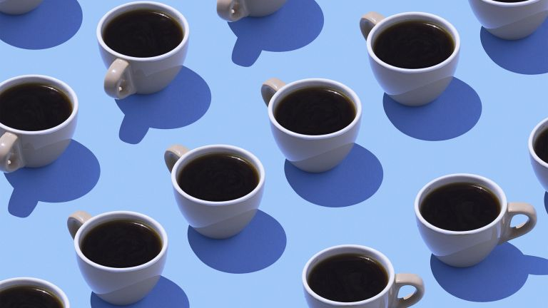 coffee cups repeated on blue background