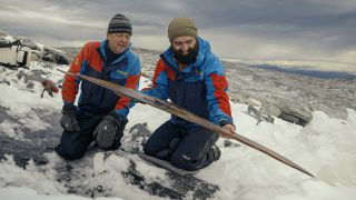 Archaeologists Espen Finstad (left) of Secrets of the Ice, and Julian Post-Melbye, of the Museum of Cultural History inOslo, admire the ski.