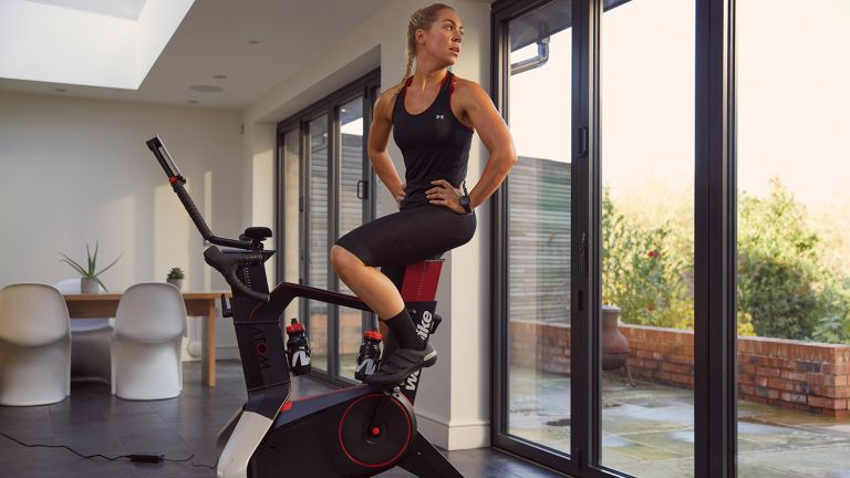 A woman working out on the Wattbike Atom exercise bike