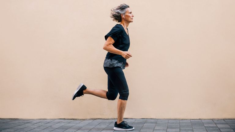 Woman in her 50s running to lose weight