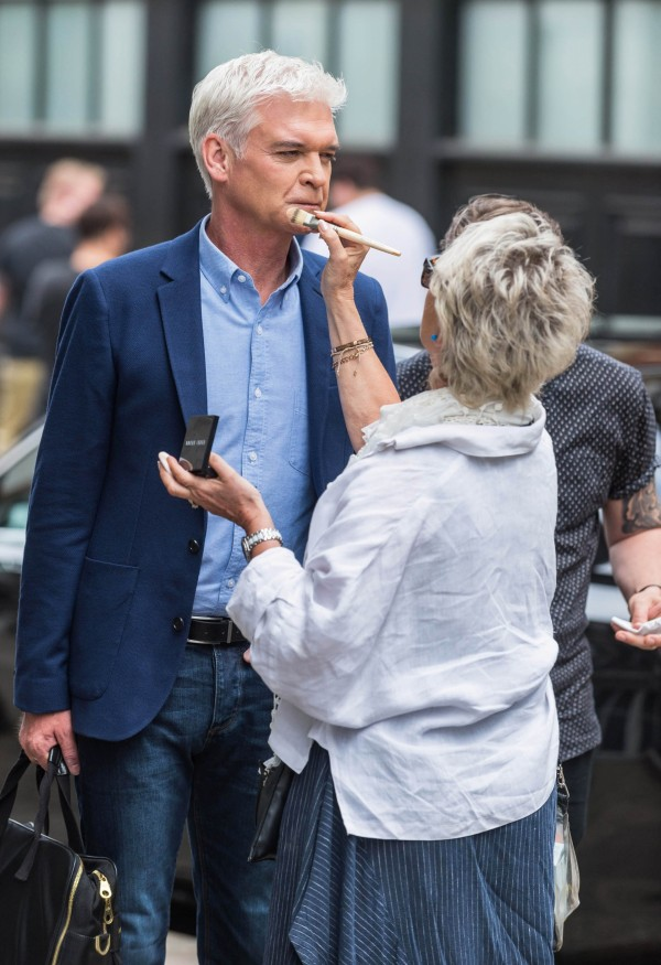 Phillip gets his make-up touched up on set (ITV Pictures)