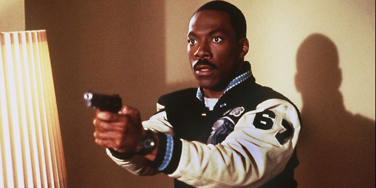 Axel Foley (Eddie Murphy) holds up a gun in Beverly Hills Cop IV (1994)