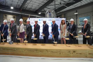 Houston Mayor Sylvester Turner, sixth from left, Houston Airports director Mario Diaz, fifth from left and Collins Aerospace vice president Allen Flynt, fourth from right, join other city, spaceport and company officials in ceremonially breaking ground for Collins Aerospace's new campus at Houston Airport on Monday, June 7, 2021 at the Lone Star Flight Museum at Ellington Airport in Houston, Texas.