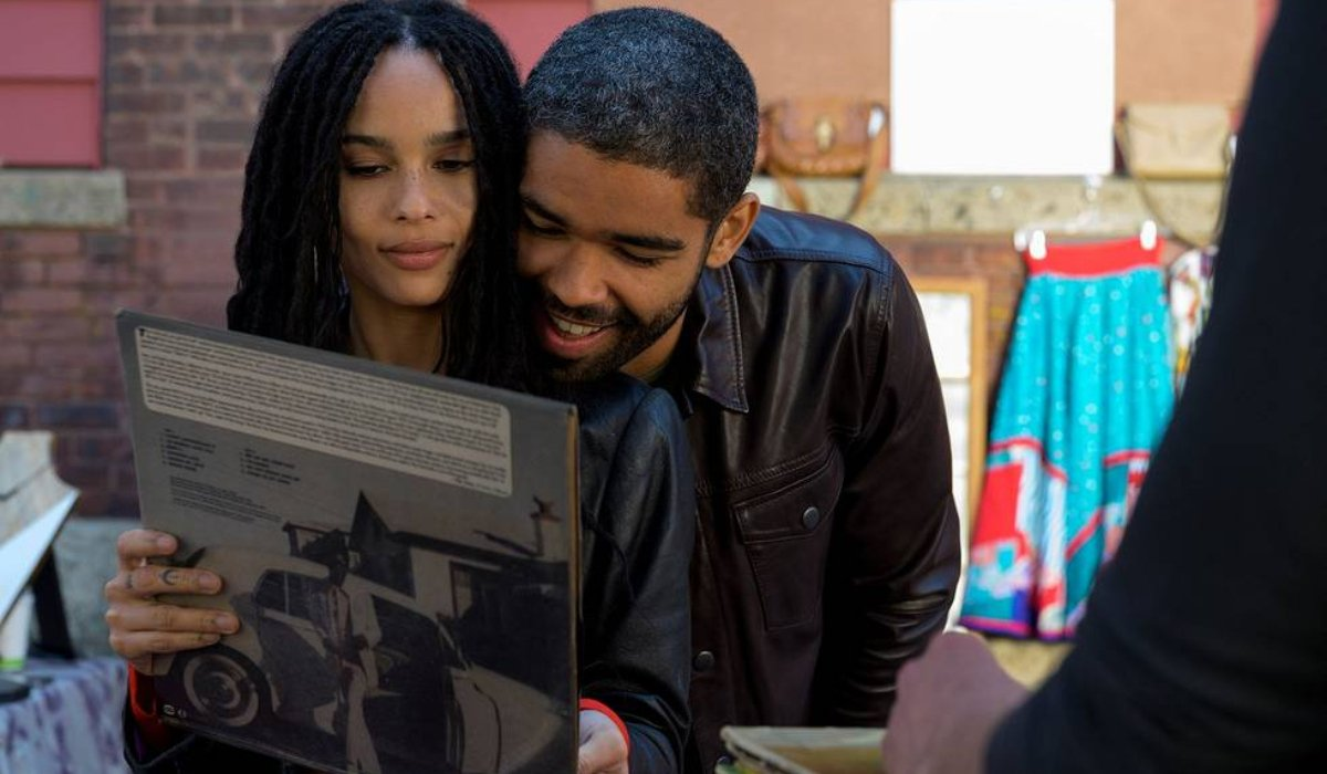 High Fidelity Zoe Kravitz checks out a record, with a guy over her shoulder
