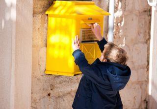 Boy mailing letter