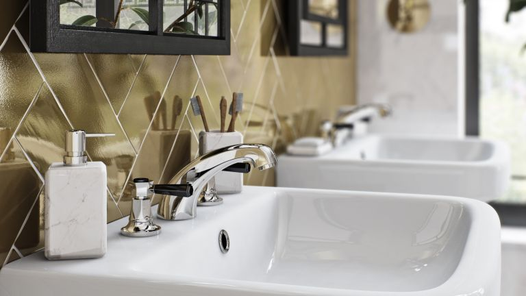 bathroom sink with gold tiles