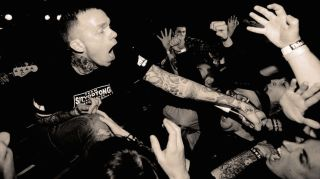 Converge's Jacob Bannon in the crowd, thrusting his mic to the audience