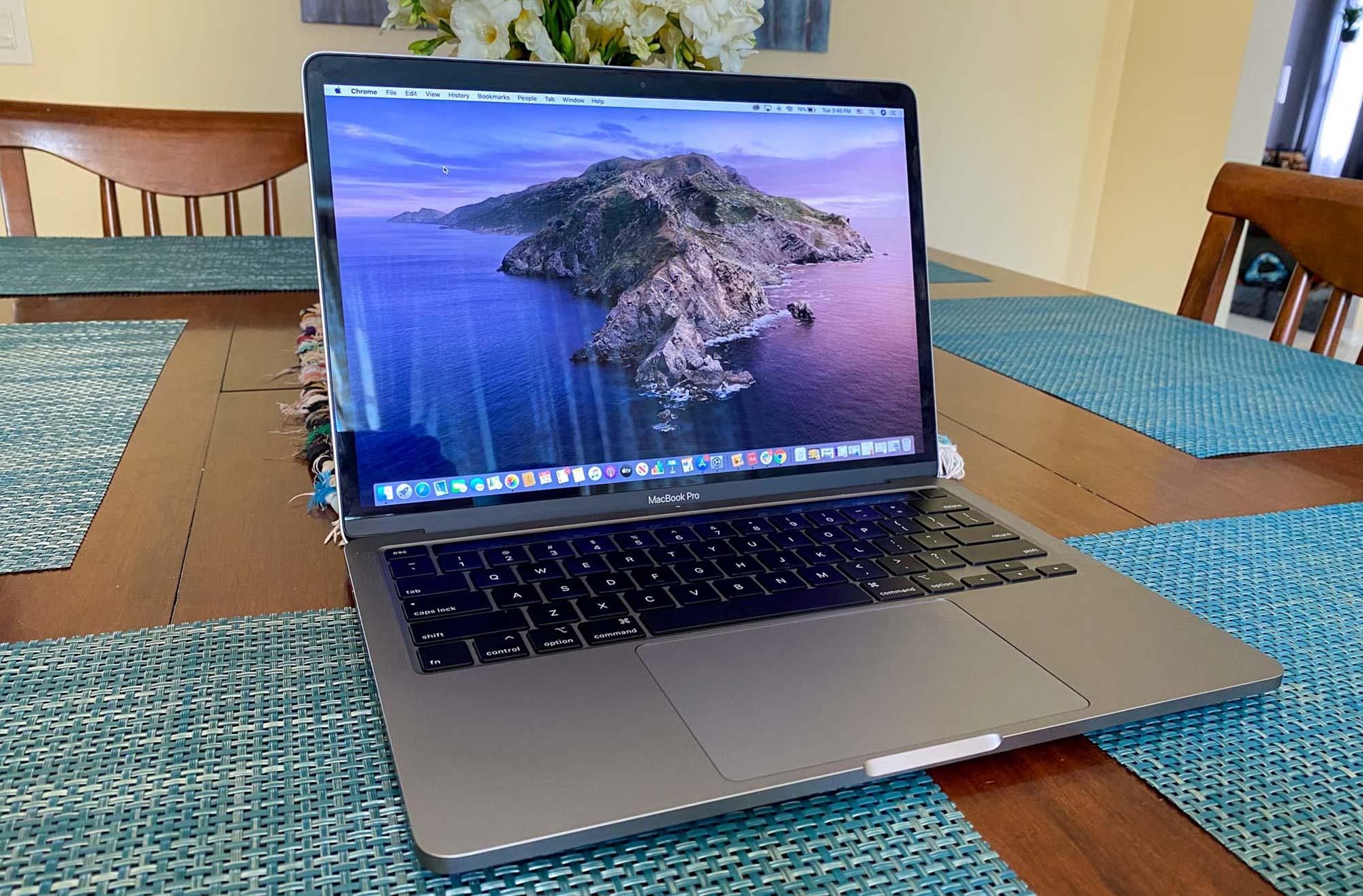 Dell XPS 13 vs MacBook Pro - MacBook Pro at table
