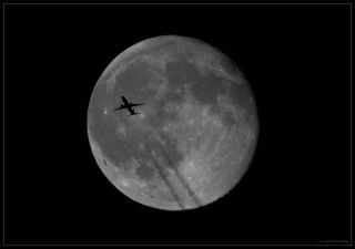 airplane full moon