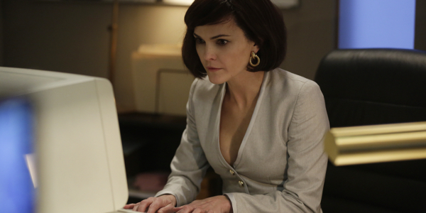 The Americans Keri Russell  operating a computer in disguise