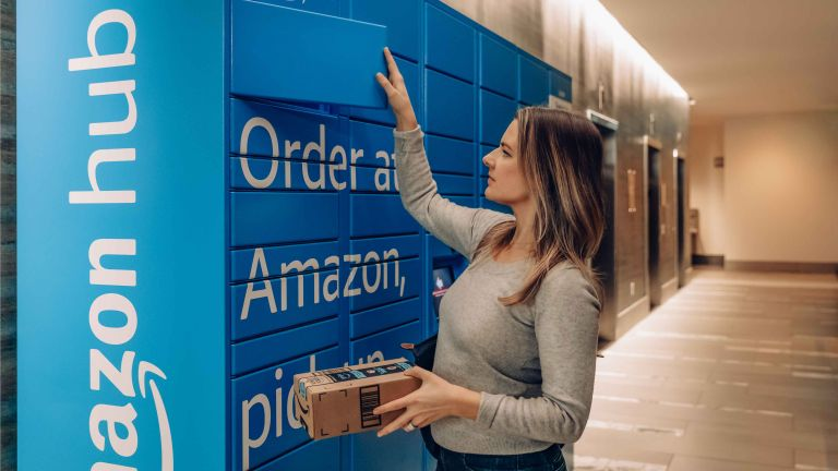 Amazon Prime Day 2020: woman picking up parcel from Amazon locker