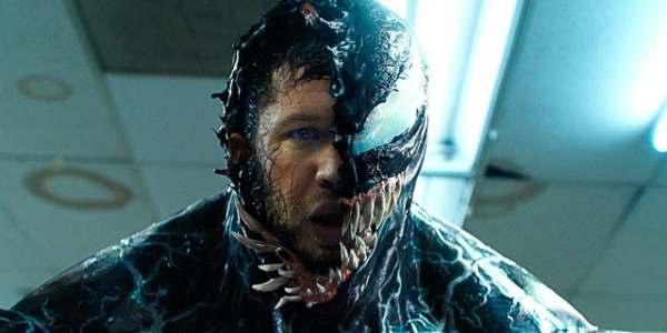 Tom Hardy's face half covered by Venom