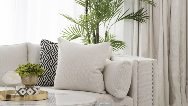 Colors to make a room look bigger, cream sofa with soft furnishing