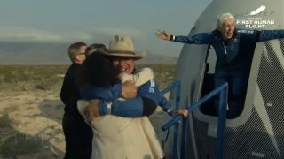 Jeff Bezos and Wally Funk after the landing of the first crewed Blue Origin flight.