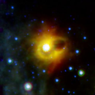 A mysterious ring surrounds magnetar SGR 1900+14, as captured by NASA's Spitzer Space Telescope.