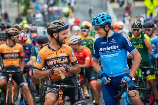 Oscar Sevilla (Medellin) and Francisco Mancebo (Inteja) catch up on the start line before the road race at the Winston-Salem Cycling Classic