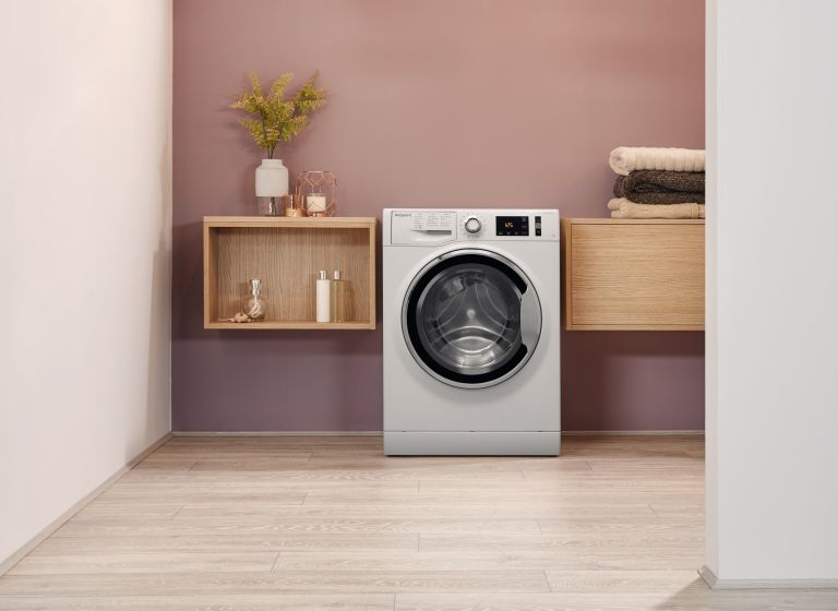 Hotpoint ActiveCare NM111064WCAUKN washing machine in utility room