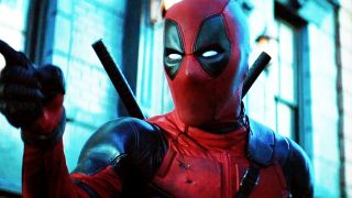 Ryan Reynolds as Wade Wilson, pointing off-screen in Deadpool 2