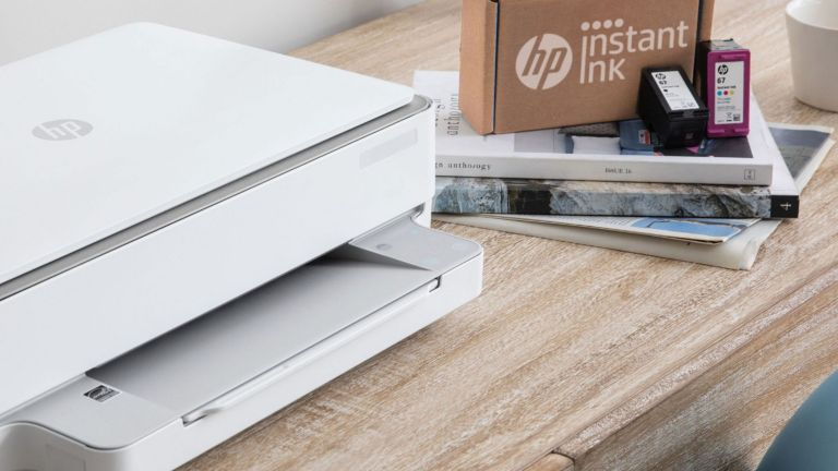 HP printer with HP instant ink package beside