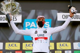 CHIROUBLES FRANCE MARCH 10 Podium Brandon Mcnulty of United States and UAE Team Emirates White best young jersey Celebration during the 79th Paris Nice 2021 Stage 4 a 1875km stage from ChalonSurSane to Chiroubles 702m Mask Covid safety measures Trophy Flowers ParisNice on March 10 2021 in Chiroubles France Photo by Bas CzerwinskiGetty Images